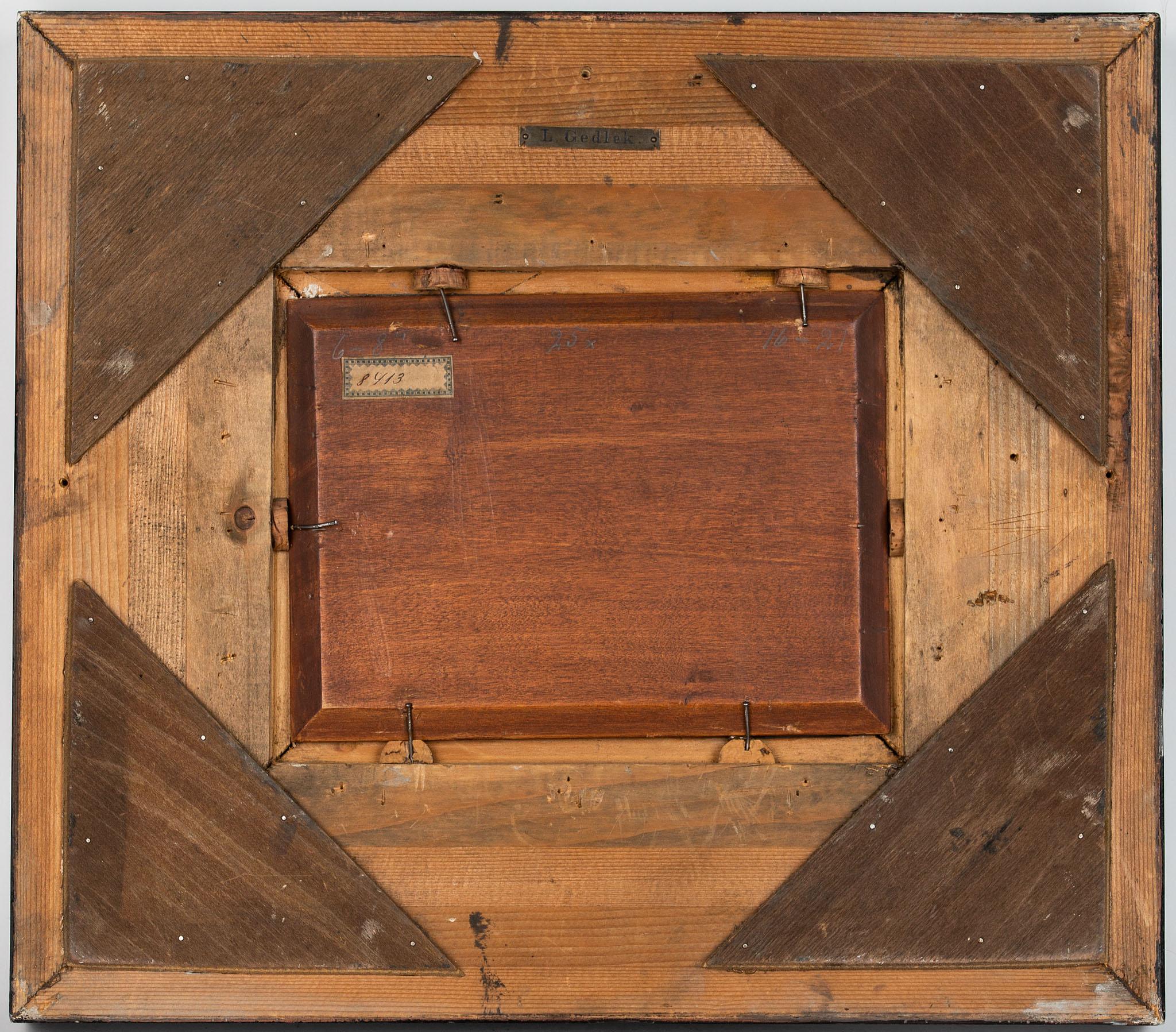 Szlachetne podobrazie w postaci mahoniowej, fazowanej deski użyte przez Ludwika Gędłka.